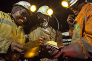 Miners at Goedehoop Colliery in South Africa referring to checklists