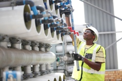 An employee makes adjustments to the reverse osmosis filters at the Emalahleni water reclamation plant.