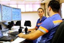 Employees in the control room at Barro Alto, Brazil