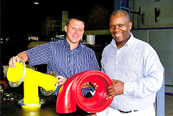 Business partners Trevor Carolin and Veli Thwala of Urethane Moulded Products